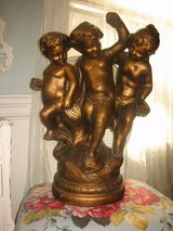 gold statue of 3  children in Naperville, Illinois