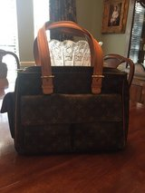 Louis Vuitton bag (authentic, purchased at Neuman Marcus, I have receipt) in Kingwood, Texas