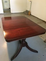 Cherry dining room table in Fort Campbell, Kentucky