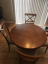 wooden dinning table with 4 chairs. in New Lenox, Illinois
