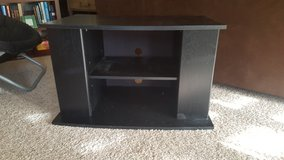 Black TV Stand with shelves on side in Perry, Georgia