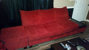 Red sectional with red wood side tables in Perry, Georgia