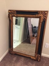 Black and gold mirror in The Woodlands, Texas