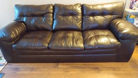 Dark Brown color couch in Fort Lewis, Washington