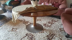 Round wood table with a special food in Wiesbaden, GE