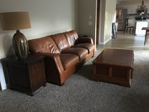 Brown leather couch, chair and ottoman in Naperville, Illinois