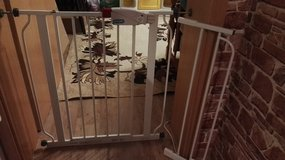Walk through baby gate. New condition.with extension in Ramstein, Germany