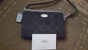Small Authentic Coach wristlet like brand new!! in Joliet, Illinois