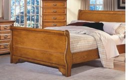 Sleigh style bed frame Queen in Fort Carson, Colorado