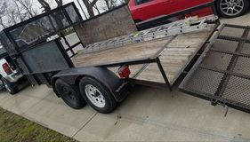 Dual axle bumper pull trailer 14 feet long by 7 feet wide New taillights and wiring Trailer brak... in Fort Campbell, Kentucky