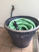 Hose with nozzle in pot holder in Okinawa, Japan