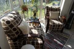 Two brown and beige patterned reclinable chairs in Ramstein, Germany