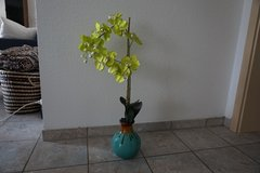 Bright green orchid faux plant with brown and teal pot in Baumholder, GE