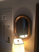 Brass framed oval mirror in Chicago, Illinois