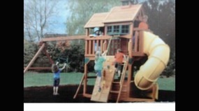 Cedar Summit Play set swing set with tube slide and climbing wall in Lockport, Illinois