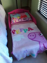 New toddler bed w/peppa Pig attire in Joliet, Illinois