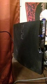 PS3 Slim 320GB, 3 Controllers, 2 Games in Fort Campbell, Kentucky