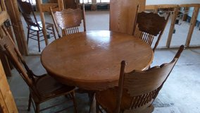 "Oak round table 48"" diameter, leaf 24"" and four chairs in Kingwood, Texas"