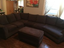 Gray sectional couch and ottoman in Fort Leonard Wood, Missouri