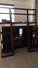 wooden desk and bookshelves and chair in Fort Bliss, Texas