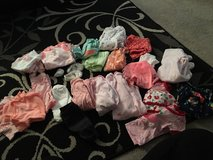 lots of new born onesies pants sleep n plays outfits socks shoes  $15 for all in Vacaville, California