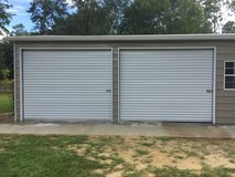 2 New Garage Doors with Liftmaster Electric Motors and Separate Remote Controls in Biloxi, Mississippi