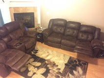 leather/micro fiber couch and love seat w/ endtables and rug in Perry, Georgia