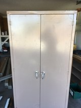 Metal storage cabinet with doors in Alamogordo, New Mexico