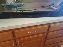 Sharp Soundbar with Subwoofer and remote in Fort Riley, Kansas