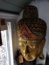 Buddha wall mask in Lakenheath, UK