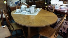 Oval oak table with 4 chairs in Naperville, Illinois