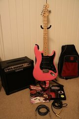 Pink electric guitar in Lakenheath, UK