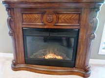 ELECTRIC HEATING INFRARED WOOD-BURNING LOOKING WOOD CARVED DESIGNER FIREPLACE, w/REMOTE! in Sugar Land, Texas