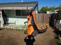 1 year old, 7 1/2 ft. blow up dragon, lights up in fire motion orange color, plug in, fan engine... in Travis AFB, California