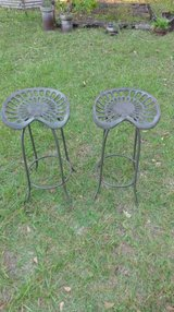 Two tractor seat bar stoolS in Hinesville, Georgia