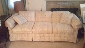 Cream colored couch with floral pattern in DeKalb, Illinois
