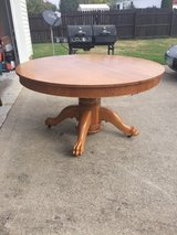 Round oak kitchen table in Pleasant View, Tennessee