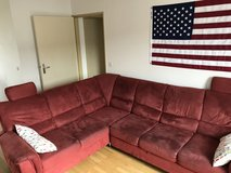 Red sectional couch in Baumholder, GE