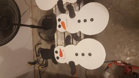 Wooden Snowmen in Fort Riley, Kansas