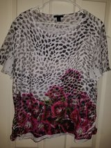 Ladies white and black floral blouse in Kingwood, Texas