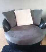 Grey and black swivel couch in Okinawa, Japan