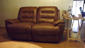 Med. Brown leather loveseat in Cherry Point, North Carolina
