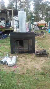 propane fireplace with logs in Coldspring, Texas