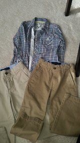 BOYS two pairs of Tommy hilfiger khaki pants and guess dress shirt in Bolingbrook, Illinois