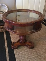 "Small round table glass sides and top. Top dose open.  20 1/2.   Across. 22""tall in Conroe, Texas"