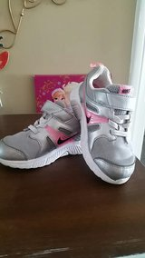 Silver toddler nikes 9C in Fort Campbell, Kentucky