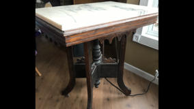 Old table with marble top in Fort Leonard Wood, Missouri