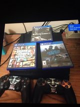 PS4 2 controllers  and 3 games in Shorewood, Illinois