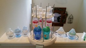 Baby Bottle Drying rack with lot of Tommee Tippee bottles and sippy cups in Houston, Texas