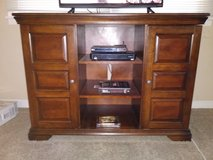 TV stand with cabinets. Very expensive piece in Kankakee, Illinois